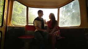 Couple riding in a tram through the forest stock video footage