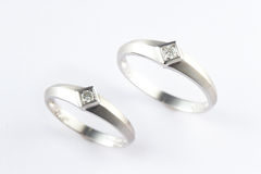 Couple ring. White gold couple ring with white background Royalty Free Stock Images