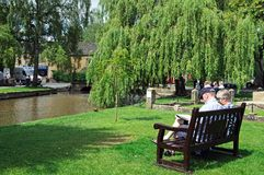 Couple by river, Bourton on the Water. Stock Photos