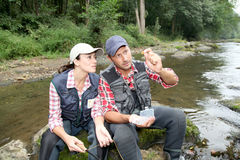 Couple in river on a fishing day Royalty Free Stock Image