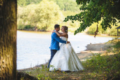 Couple at River`s Bank. Couple hugging at river`s bank Stock Image