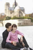 Couple At Riverbank Against Notre Dame Cathedral Royalty Free Stock Photo
