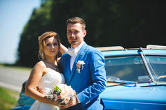 Couple by Road. Couple with flowers at car by road Royalty Free Stock Photography