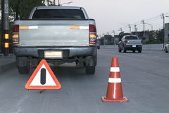 Traffic cone and Alarm Signs stock photos