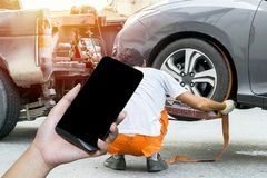 Using a mobile phone call a car mechanic . royalty free stock photography