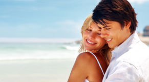 Couple roaming at the sea shore Stock Image