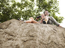 Couple On Rock With Binoculars Looking At View Stock Photos