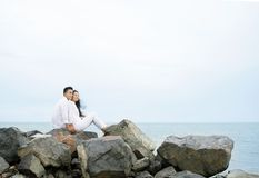 Couple on rocks Royalty Free Stock Image