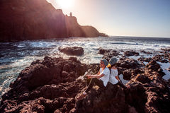 Couple on the rocky coast Stock Image