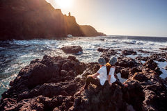 Couple on the rocky coast Royalty Free Stock Photography