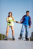 Couple of roller skaters Royalty Free Stock Photo