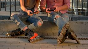Couple on rollerblades is sitting. stock video footage