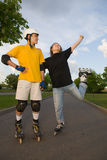 Couple rollerblading Royalty Free Stock Image