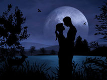 Couple in Romance. Romantic couple at night with nice moonshine Royalty Free Stock Images