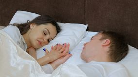 Couple romance closeness love touch hold hand bed stock footage