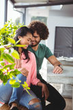 Couple romancing in cafeteria Stock Images