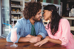 Couple romancing in cafeteria Royalty Free Stock Image
