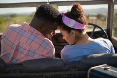 Couple romancing in a car. At countryside Stock Photography