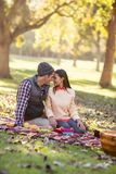 Couple romancing at park. Couple romancing against trees at park Royalty Free Stock Photo