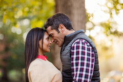 Couple romancing at park. Side view of couple romancing at park Stock Images