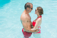 Couple romancing in swimming pool Stock Photo