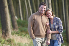 Couple On Romantic Country Walk Through Woodland Stock Image