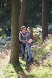 Couple On Romantic Country Walk Through Woodland Royalty Free Stock Photos