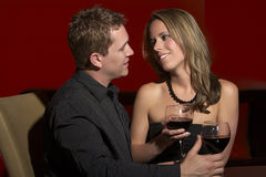 Couple Romantic Date. Happy Couple on a Romantic Date in  Restaurant Stock Image