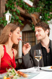 Couple on romantic date at a restaurant Stock Photo