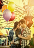 Couple at romantic dating in amusement park. Young couple at romantic dating in amusement park royalty free stock photography