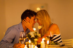 Couple romantic dinner. Young loving couple having romantic dinner together Stock Image