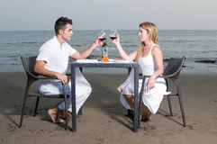 Couple at a romantic dinner in the beach Royalty Free Stock Photography