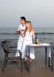 Couple at a romantic dinner in the beach Royalty Free Stock Images
