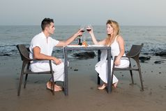 Couple at a romantic dinner in the beach Stock Images