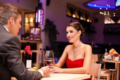 Couple in a romantic dinner. Drinking  with wine Royalty Free Stock Images