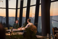 Couple on a romantic dinner at the restaurant. Couple celebrate Valentine`s day with romantic dinner in restaurant near the window stock photography