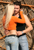 Couple in a romantic pose. A young blonde couple hugging each other Stock Photo