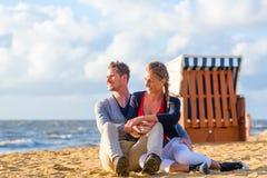 Couple in romantic sunset on beach Stock Image