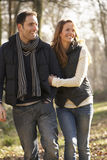 Couple on romantic walk in winter Royalty Free Stock Images
