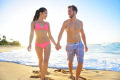 Couple romantic walking in beach sand holding hand Royalty Free Stock Image