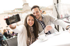 Couple in Rome. Loving couple having a cup of coffee in a cafe in Rome royalty free stock images