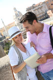 Couple in Rome websurfing on tablet Stock Photos