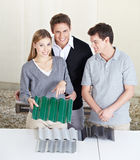 Couple at roofer with roof panels Royalty Free Stock Photo