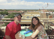 A Couple at a Rooftop Bar Overlooking Santa Fe. A Couple at a Rooftop Bar Have Seats Overlooking Santa Fe, New Mexico Royalty Free Stock Photos