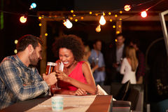 Couple at rooftop party Royalty Free Stock Photography