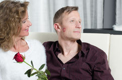 Couple with rose kissing on couch Royalty Free Stock Photo