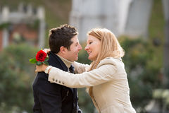 Couple with a rose kissing on valentines day Royalty Free Stock Photos