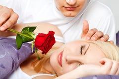 Couple rose male waking female Royalty Free Stock Image