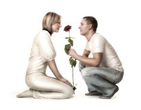 Couple and rose on white Stock Photos