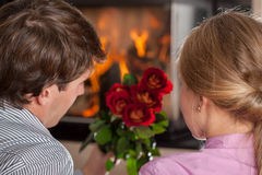 Couple, roses and fireplace Royalty Free Stock Photo